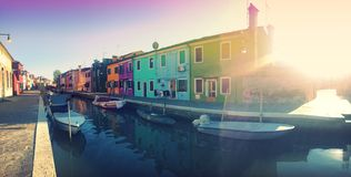 Canal in Burano, Italy. Brightly colored homes on the canal, found on the island of Burano in Venice, Italy Stock Image