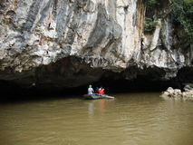 Canal into cave. Ninh Binh town, Vietnam Royalty Free Stock Photography