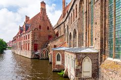 Canal with Church in Bruges. Canal with Church of Our Lady in Bruges, Belgium Stock Photo