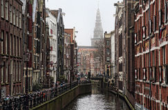 Canal and church tower in Amsterdam, Holland Royalty Free Stock Photography
