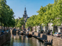 Canal and church tower in Gouda, Holland Stock Photos