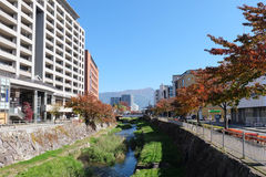 Canal in the city of Matsumoto with nature and building around Royalty Free Stock Image