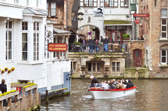 Canal city tour in Bruges, Belgium Stock Image