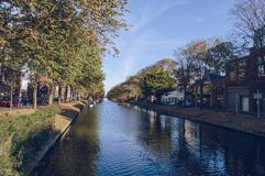 Canal with cityscape of Den Helder. View of canal and cityscape of Den Helder on saturday sunny morning royalty free stock images