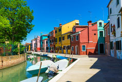 Canal and colorful buildings in Burano island, Venice Stock Images