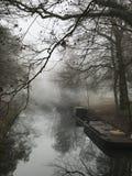 Canal con el barco de funcionamiento visto del puente Fotos de archivo