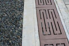 Canal con gravas en piso Foto de archivo