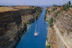 Canal of Corinth. Sailboat navigating the narrow Canal of Corinth, in Greece Royalty Free Stock Image
