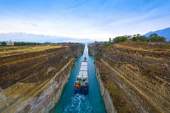 Canal of Corinth. Tug leads cargo vessel in the narrow Canal of Corinth, Greece stock photos