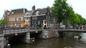 Canal crossing in Amsterdam typical view  City of Amsterdam. Canal crossing in Amsterdam typical view  Amsterdam Netherlands videoclip videoclip stock video footage