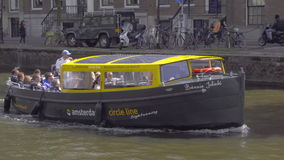 Canal cruise boat in Amsterdam stock video footage