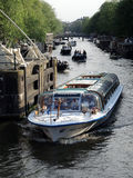 Canal Cruise Boats in Amsterdam Stock Photo