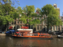 Canal cruise at a snack corner in the canals of Amsterdam Stock Photography