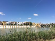 Canal de Alfonso XIII. The Canal de Alfonso XIII with the Museo Del Castillo De San Jorge in Seville Spain Royalty Free Stock Image