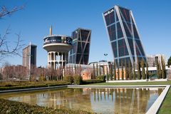 Canal de Isabel II Park, and the leaning Kio Towers in plaza de Castilla square - Madrid Royalty Free Stock Photography