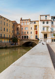 Canal de la Robine through center of city with surrounding scene Stock Photo