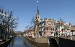 Canal in Delft. Canal and church in the old part of Delft stock images