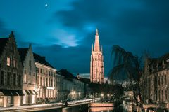 Canal Dijver and a Church of Our Lady in Bruges stock photos