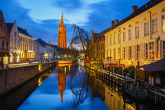 Canal Dijver and a Church of Our Lady in Bruges Royalty Free Stock Image