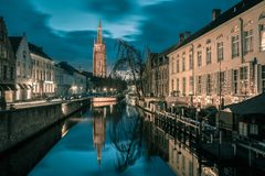 Canal Dijver and a Church of Our Lady in Bruges Royalty Free Stock Images