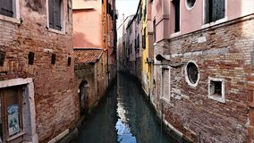 The canal and the district are Venetian old houses in its typical architecture in Venice, Italy stock image
