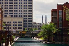 The canal in downtown Indianapolis. A colorful scene full of cars and architecture of the canal in downtown Indianapolis, Indiana royalty free stock images