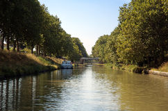Canal du Midi. Pleasure cruiser tied to the shore in the Channel du Midi in Carcassonne Stock Photos