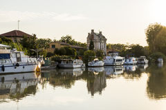 Canal du Midi, Beziers, France. Longboats in the Canal du Midi at sunset, Beziers, Southern France with an Art Nouveau house in the background. A world heritage Stock Photography
