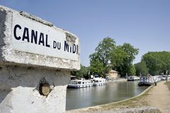 Canal du Midi. Southern France, Canal de Midi at the village of Capestang. Focused at the sign with the name of the canal Stock Photography