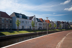 Canal in Op Buuren Buiten, The Netherlands. A canal with expensive houses in Op Buuren Buiten, The Netherlands Stock Photography