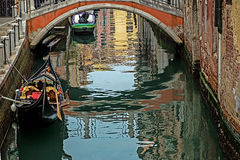 Canal with gondola in Venice, Italy Stock Images