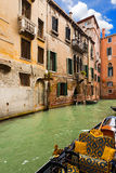 Canal and Gondola in Venice - Italy Stock Images