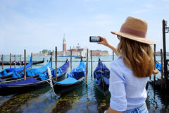Canal and gondolas with tourist eye Royalty Free Stock Image