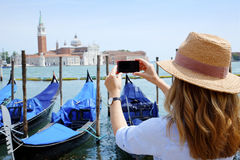 Canal and gondolas with tourist eye Stock Image