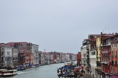 Canal with gondolas in Venice. Historical old buildings above the river in Italy. European cityscape Stock Photography