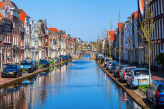 At a canal in Gouda, Netherlands. Gouda, Netherlands - April 20, 2016: canal in Gouda. Gouda is world famous for its cheese, that becomes trade here Stock Image
