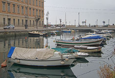 Canal grande with boats in Trieste city center Stock Image