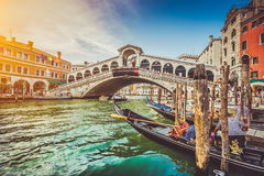 Canal Grande with famous Rialto Bridge at sunset in Venice Stock Photo