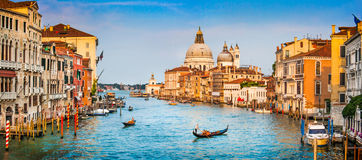 Canal Grande panorama at sunset, Venice, Italy. Panoramic view of famous Canal Grande and Basilica di Santa Maria della Salute at sunset in Venice, Italy Stock Photo