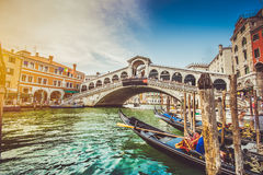 Canal Grande with Rialto Bridge at sunset, Venice, Italy. Panoramic view of famous Canal Grande with famous Rialto Bridge at sunset in Venice, Italy with retro Stock Photography