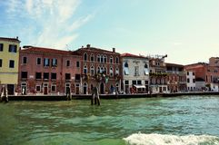 Canal Grande with typical venetian buildings construction houses, sunny day, Venice, Italy Royalty Free Stock Photography