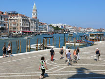 Tourists and Canal Grande, Venice royalty free stock images