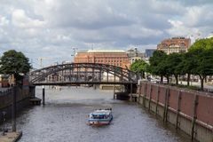 Canal in hafencity hamburg with an excursion boat stock photos