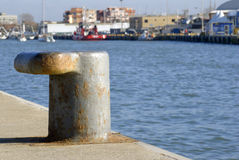 Canal harbour mooring bollard with shallow DOF Stock Photography