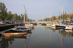 Canal in Harlingen. Moored yachts on a canal in Harlingen Royalty Free Stock Image