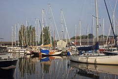 Canal in Harlingen. Moored yachts on a canal in Harlingen Royalty Free Stock Photos