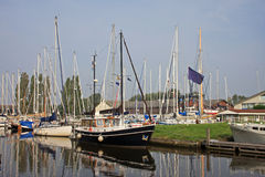 Canal in Harlingen. Boats moored on canal in Harlingen Royalty Free Stock Photos