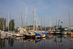 Canal in Harlingen. Boats moored on a canal in Harlingen Stock Image