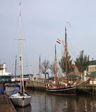 Canal in Harlingen. Traditional boats on canal in Harlingen Royalty Free Stock Images