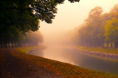 Canal in haze. Evening light over River or canal Stock Photo